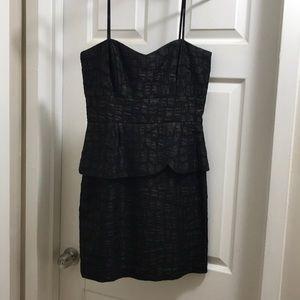 Strapless black peplum cocktail dress
